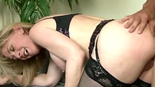 Busty blond mommy rides and sucks hard cock of her young boy