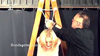 Blonde slut is suspended and dominated in a BDSM session