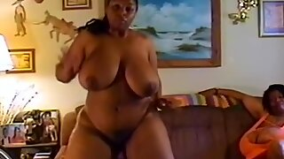 Massive XXXL African woman plays with her wide curves