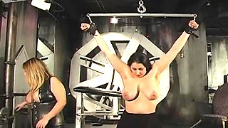 Busty mistress bounds her slave and plays with her big boobs