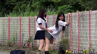 Asian teenagers outdoors urinate
