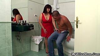 buxomy mom inlaw helps him jizm
