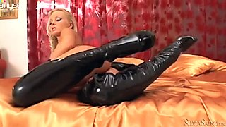 Super sexy blonde in latex boots shows off her well-shaped ass