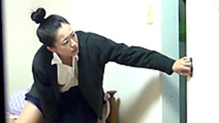 Asian in uniform rubbing