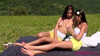 Lesbian teens in a field