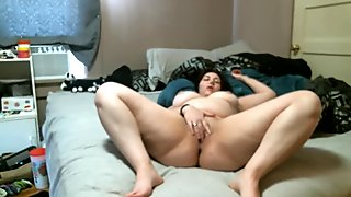 Chubby Brunette dildoes on bed