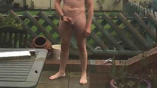 Naked and hard wanking outdoors