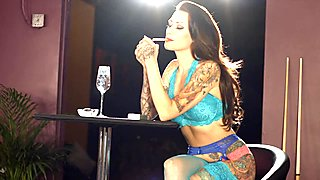 Tattooed model smoking strong cigarettes in lingerie
