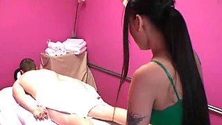 Tattooed asian masseuse jerking client cock