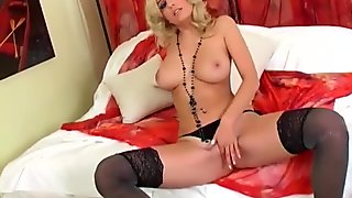 Blonde in a bra stockings and panties masturbating